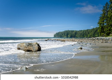 Beautiful Unspoiled Rocky Beach along the West Coast of Vancouver Island under Blue Sky. China Beach, Sooke, BC, Canada.