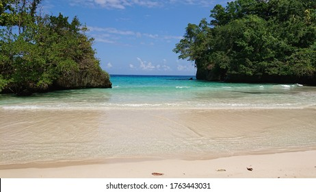 The beautiful, unspoilt sands of Frenchman's Cove, Jamaica, on a sunny March day