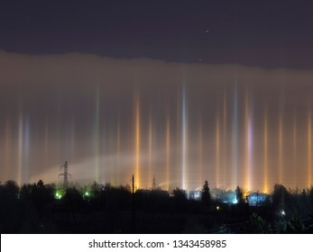 Beautiful unusual light in the sky from street lamps in a very strong frost in winter - due to the large number of small ice crystals in the air, Moscow region, Russia
