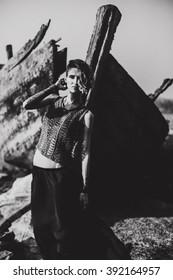 beautiful unusual woman posing in sea scenery