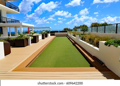 Beautiful upscale bocce ball court with artificial turf.