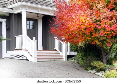 Beautiful upscale house in Canada with a Maple leaf tree next to the front door. Also available in vertical.