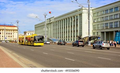 Beautiful urban landscape of Minsk. Eastern European cities. CBD. City infrastructure. City Business District. National flag of Belarus in blue sky background. Minsk, Belarus – May 16, 2016