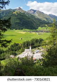 The beautiful valley of Kals am Grossglockner in Tirol, Austria, with the iconic mountains Blauspitze and Kendelspitze, part of the Hohe Tauern nature reserve, in the background.
