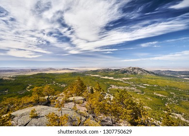 Beautiful valley of rocky mountains with pine woods of Karkaraly national park in Central Kazakhstan
