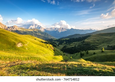 Beautiful valley Val di Fassa near Canazei, Dolomites, Italy. View from Passo Sella. Marmolada glacier on the left in background.