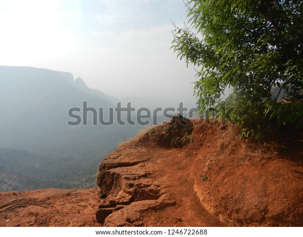 beautiful valley view with red sandstone and green trees