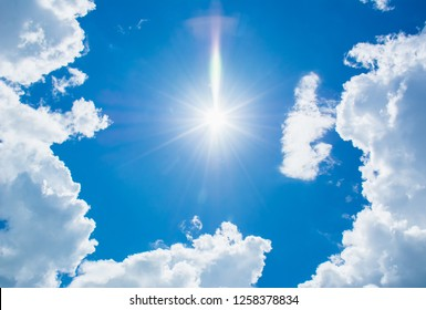 Beautiful vast  blue sky and white cloud with sunray background. Shape independent, Elements of nature.