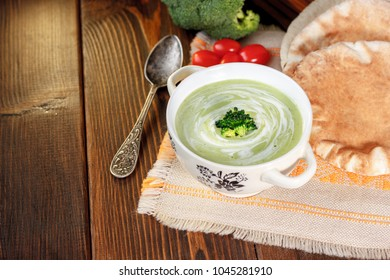 Beautiful vegetarian broccoli soup in a white bowl.