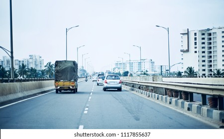 Beautiful vehicles are running on the Bangalore city flyover in India unique photo