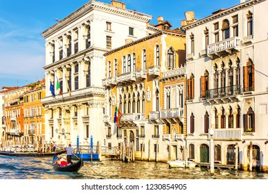 Beautiful venetian palaces and a gondolier in Grand Canal