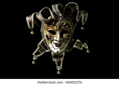 Beautiful venetian souvenir mask on black background