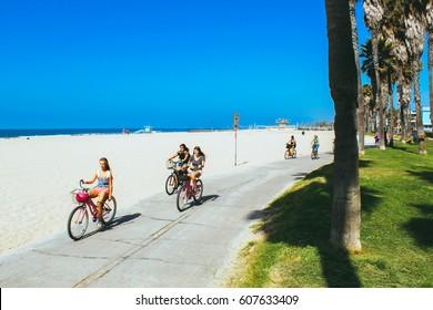 Beautiful Venice beach area in Los Angeles. Bicycles riding down the ocean near the beach. Beautiful Californian spirit.