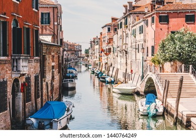 Beautiful Venice cityscape, houses and boats along canal