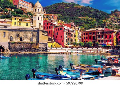 Beautiful Vernazza village with tourists on the beach, scenic place in Cinque Terre, Italy.