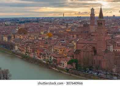 Beautiful Verona at the sunset light  and  Sant  Anastasia Church and Torre dei Lamberti or Lamberti Tower.