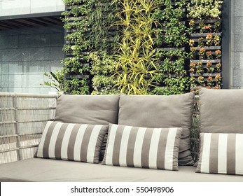 Beautiful vertical garden with outdoor sofa for family relaxing zone