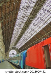 A beautiful vertical shot of the Keleti Railway Station in Budapest, Hungary, with colorful trains