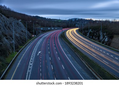 Beautiful very long exposure evening view of light trails of vehicles on motorway M50 Dublin, Ireland. Transportation during Level 5 in Dublin