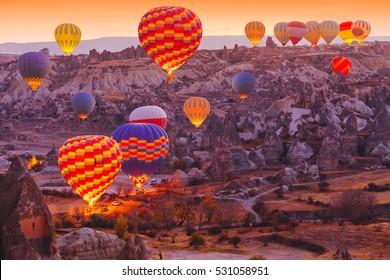 Beautiful vibrant colorful balloons in sunrise light in Cappadocia.