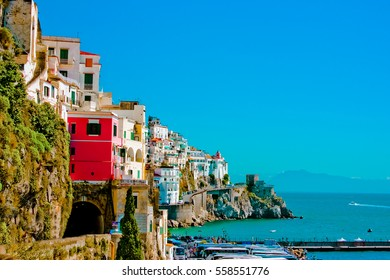 Beautiful vibrant colorful view of clill side village homes and sea of the Amalfi coast in Italy.