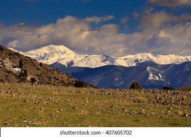 Beautiful and vibrant early Springtime mountain landscape with dramatic sky.
