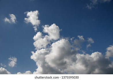 A beautiful vibrant sky cloudscape scene, with white coloured billowing cumulonimbus cloud formation in a mid blue sky. Atmospheric beauty in nature. New South Wales, Australia.