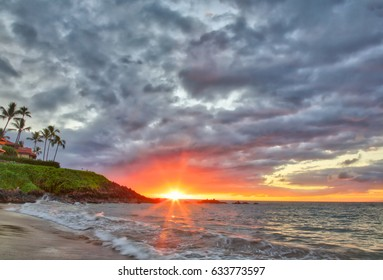 Beautiful and vibrant sunset under a cloudy sky at Wailea Beach in Wailea, Maui, Hawaii