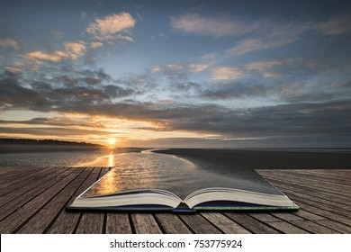 Beautiful vibrant Winter sunrise over low tide beach  concept coming out of pages in open book