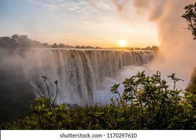 Beautiful Victoria Falls on the boarder of Zimbabwe and Zambia.  The Zambezi river flows and forms one of the seven natural wonders of the world.