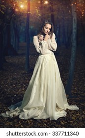 Beautiful victorian dressed woman in fairy forest. Romantic and fantasy
