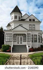 Beautiful Victorian white house with a lawn in front