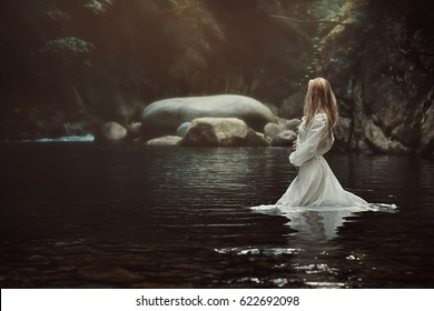 Beautiful victorian woman in mystical stream. Fantasy and fairytale
