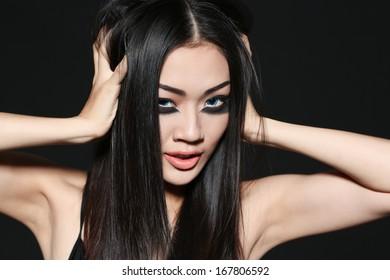 Beautiful Vietnamese girl with black mascara under eyes