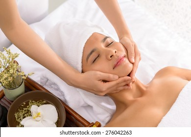 Beautiful Vietnamese girl relaxing in spa salon