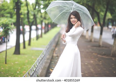 Beautiful vietnamese girl with traditional dress (ao dai) and a umbrella in Hanoi, Vietnam