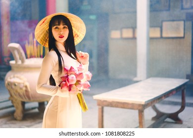 Beautiful vietnamese woman in Ao Dai white-traditional dress of vietnam, Ho Chi Minh city Vietnam