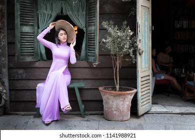 Beautiful vietnamese woman in Ao Dai white-traditional dress of vietnam, Ho Chi Minh city Vietnam