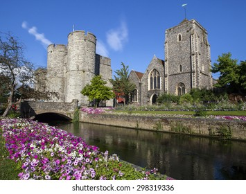 A beautiful view across the River Stour of Westgate and the Guildhall in Canterbury, Kent.
