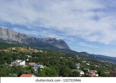 Beautiful view of AI-Petri mountain from the Eastern outskirts of Alupka village. Yalta, Crimea, Russia