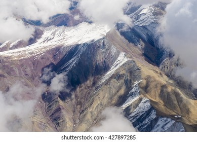 Beautiful view from the aircraft to the mountains of Himalaya