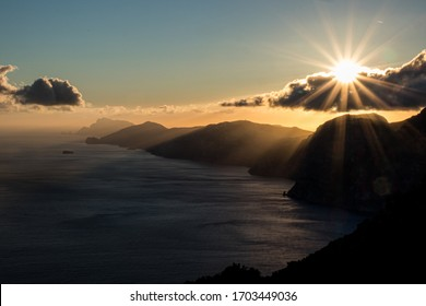 Beautiful view of Amalfi coast seen from the Path of the Gods (Sentiero degli Dei) with Li Galli and Capri Island on the background at sunset. Route from Agerola to Nocelle, Positano, Campania, Italy
