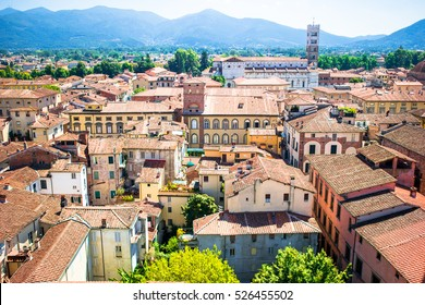 Beautiful view of ancient building with red roofs in Lucca, Italy