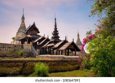 Beautiful view of ancient temple in old Bagan with flowers foreground, Myanmar, Burma