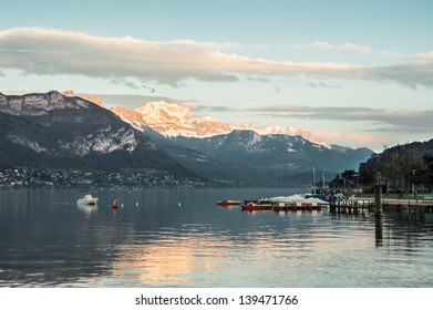 Beautiful view of the Annecy Lake in French Alps, a spring day with snow, at dusk in the mountains. Annecy. Haute Savoie. French Alps. France.
