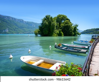 Beautiful view of the Annecy Lake in French Alps, a summer day with boats in the foreground. Annecy. Haute Savoie. French Alps. France.