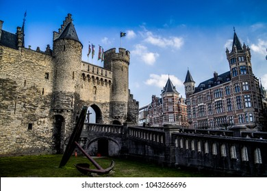 Beautiful view of Antwerp city in Belgium, its historic monumental landmarks. Traditional flemish architecture in Belgium - Antwerpen city. View of historic houses and retro cafe on street of Belgium.