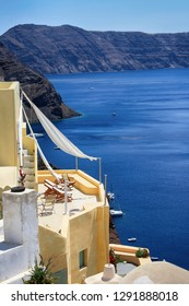 Beautiful view of apartments with a balcony and the sea on the island of Santorini in Greece