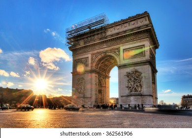 Beautiful view of the Arc de Triomphe at sunset in Paris, France