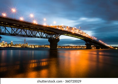 Beautiful view of Auckland Harbor Bridge during blue hour.